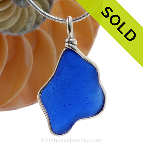 A LARGE irregular perfect piece of Cobalt Blue Genuine Sea Glass with in our signature Original Wire Bezel© pendant setting. Sorry this sea glass jewelry selection is no longer available.