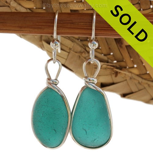 An amazing match in Sea Glass Earrings in a Vivid Teal or Aqua set in our Original Wire Bezel© setting in silver. ULTRA ULTRA RARE!  Sorry this sea glass jewelry selection has been SOLD!