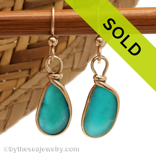 A mixture of electric aqua tones in this Victorian era sea glass earring pair. Unique and special! Sorry this sea glass jewelry selection has been sold!