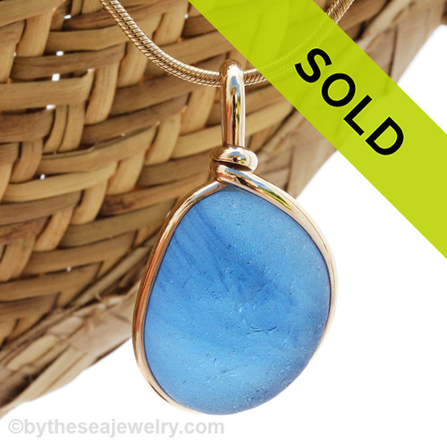 Mixed Blue  EndODay sea glass set in our Original Wire Bezel© pendant setting in gold. Classic and timeless. Sorry this sea glass pendant is no longer available.