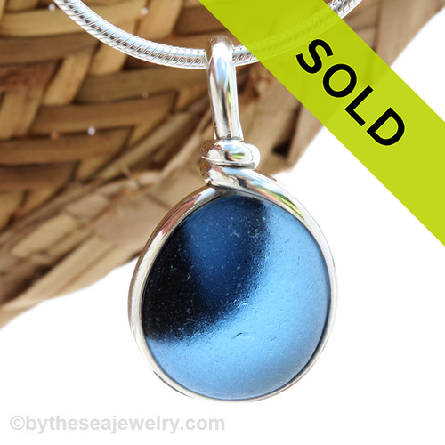 A lovely piece of mixed blue Victorian Era Art glass perfectly encased in our Original Wire Bezel© setting in silver Sea Glass Pendant. Sorry this sea glass jewelry selection has been sold!