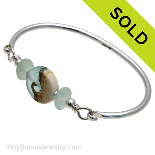 Two pieces of beach found sea glass in pale aqua on this solid sterling silver half round sea glass bangle bracelet.  Sorry this Sea Glass Jewelry piece is NO LONGER AVAILABLE!