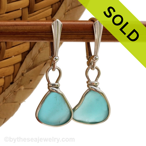 Thick petite pieces of naturally collected Aqua Blue sea glass in our ORIGINAL Wire Bezel© setting in Silver. This sea glass is unaltered from the way it was found on the beach. Elegant and timeless. Sorry this sea glass jewelry selection has been sold!