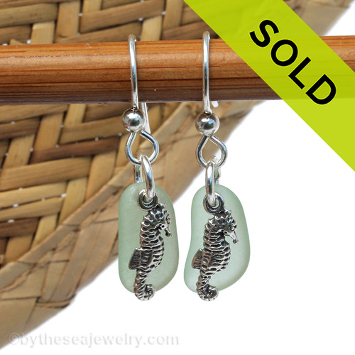 A perfect matched pair of beautiful seafoam green sea glass earrings combined with solid sterling seahorse  charms and a setting that leaves much of the beauty of these sea glass pieces shine. SOLD - Sorry This Sea Glass Jewerly Selection Is NO LONGER AVAILABLE!