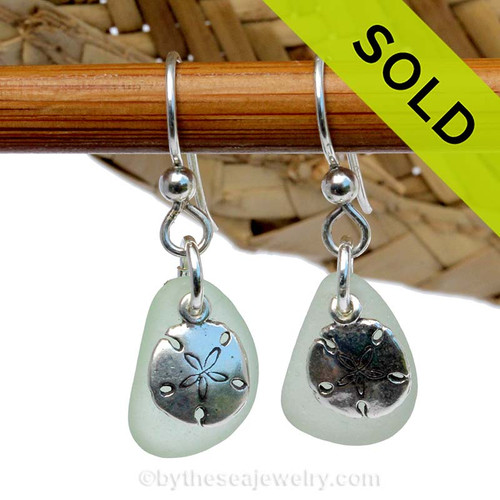 A perfect matched pair of beautiful seafoam green sea glass earrings combined with solid sterling sandollar charms and a setting that leaves much of the beauty of these sea glass pieces shine. SOLD - Sorry these Sea Glass Earrings are NO LONGER AVAILABLE!