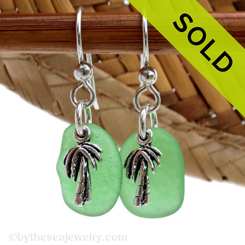 A simple pair of genuine green sea glass earrings with sterling silver pal tree charms in a lightweight simple setting. SOLD - Sorry these Sea Glass Earrings are NO LONGER AVAILABLE!