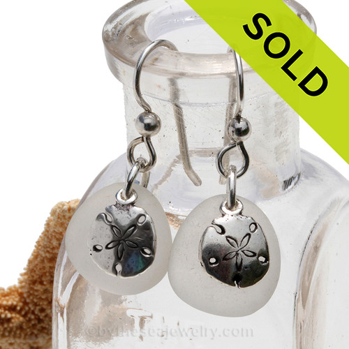 Beach found white sea glass earrings with solid sterling sandollar charms. SOLD - These Sea Glass Earrings are NO LONGER AVAILABLE!