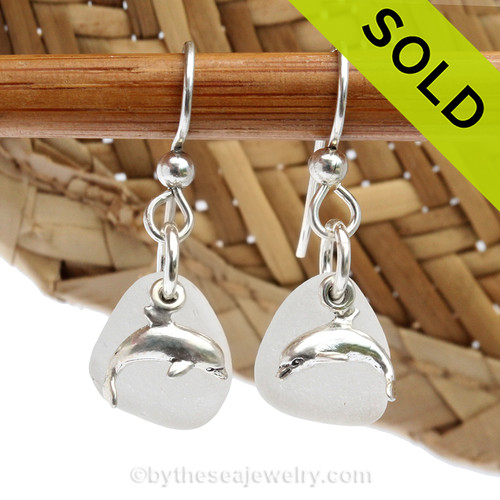 Beach found white sea glass pieces with solid sterling sea dolphin charms.  Sorry these Sea Glass Earrings have been SOLD!