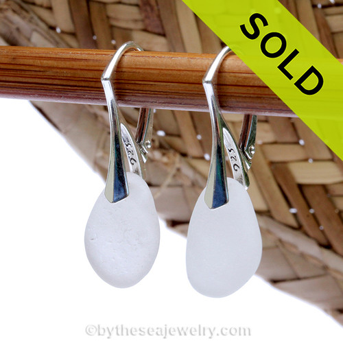 A pair of natural surf tumbled sea glass earrings in a Pure White on sterling leverback earrings. Sorry these sea glass earrings have been sold!