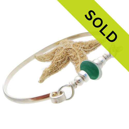 This mixed green sea glass bangle bracelet has been sold!
