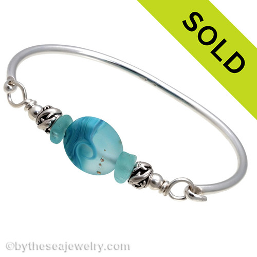 Two pieces of beach found sea glass in vivid tropical aqua on this solid sterling silver FULL ROUND sea glass bangle bracelet.  Sorry this sea glass jewelry selection has been sold!