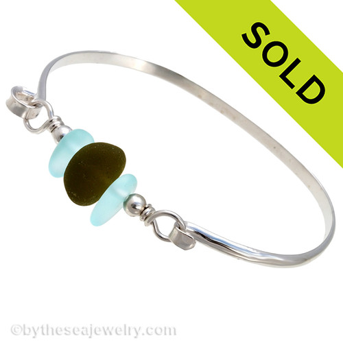 A thick piece of very round piece of seaweed green English Seaham Sea Glass combined with two bright aqua beads on a solid sterling bangle bracelet. SOLD - Sorry this Sea Glass Bangle Bracelet is NO LONGER AVAILABLE!