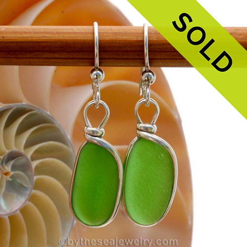 Genuine beach found Bright Glowing Mermaids Emerald Green Sea Glass Earrings in a Solid Sterling Silver Original Wire Bezel© setting. SOLD - Sorry this Sea Glass Jewelry selection is NO LONGER AVAILABLE!