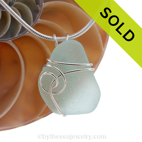 A nice TOP QUALITY piece of seafoam green sea glass set in our signature Sea Swirl© setting in sterling silver. Sorry this sea glass jewelry piece has been sold!