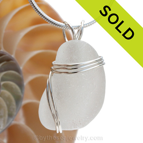 A thick piece of genuine sea glass in pure white and a triple solid sterling silver setting. Sold - sorry this Sea Glass Jewelry selection is no longer available.