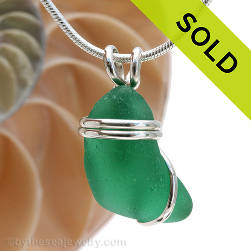 An VERY unusual green with set in a simple secure sterling necklace pendant setting. Sorry this Exact Sea Glass Pendant has been SOLD!