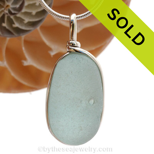 A large piece of dimpled beach found glass from Seaham England in aqua is set in our Original Wire Bezel© pendant setting. SOLD - Sorry this Sea Glass Jewelry selection is NO LONGER AVAILABLE!