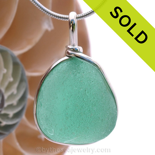 A P-E-R-F-E-C-T piece of beach found glass from Seaham England in aqua is set in our Original Wire Bezel© pendant setting. SOLD - Sorry this Ultra Rare Sea Glass Pendant is NO LONGER AVAILABLE!