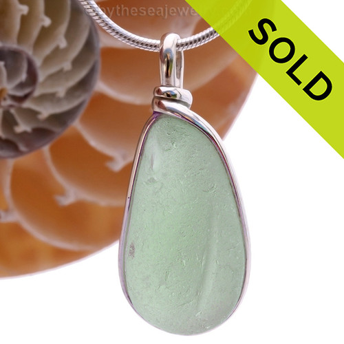 A beautiful long large and thick piece of seafoam green sea glass set in our Original Wire Bezel pendant setting. This leaves the sea glass piece totally unaltered from the way it was found on the beach! Sorry this Sea Glass Jewelry selection has been SOLD!