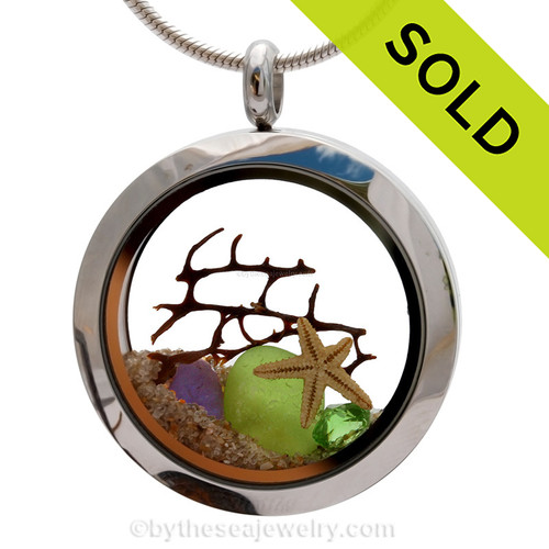 Genuine lime green and blue sea glass piece combined with a bit of vintage sea fan, stafish and a real beach sand in this stainless steel locket. Sorry this sea glass locket necklace has been sold!