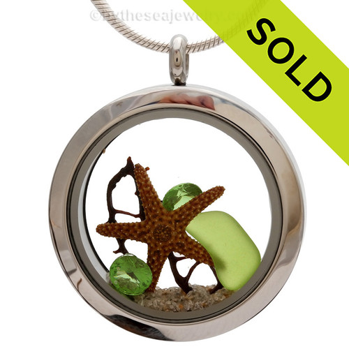 Genuine lime green sea glass piece combined with a bit of vintage sea fan, starfish and a real beach sand in this stainless steel locket. Sorry this piece of sea glass jewelry has been sold!