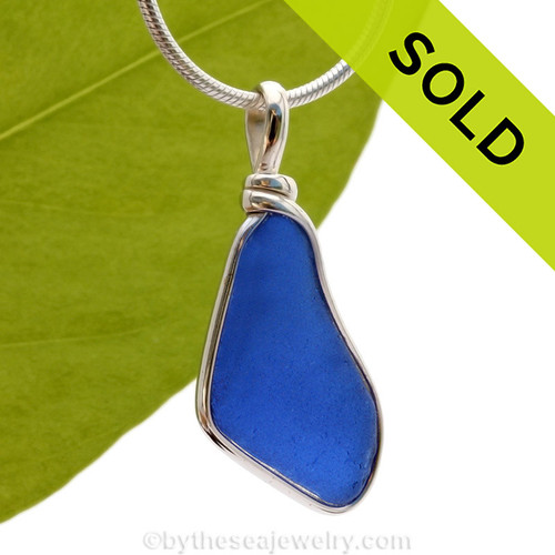 A smaller flat and thinner piece of Cobalt Blue Genuine Sea Glass with in our signature Original Wire Bezel© pendant setting. Sorry this sea glass jewelry piece has been sold!