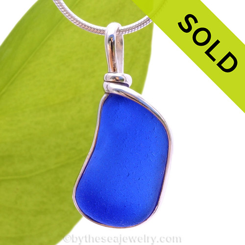 A curvy piece of Cobalt Blue Genuine Sea Glass with in our signature Original Wire Bezel© pendant setting. Sorry this Sea Glass Pendant has been SOLD!