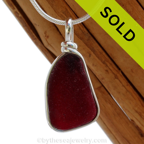 A deep almost black red sea glass is set in our Original Wire Bezel© pendant setting. Sorry this rare piece of Red Sea Glass Jewelry has been SOLD