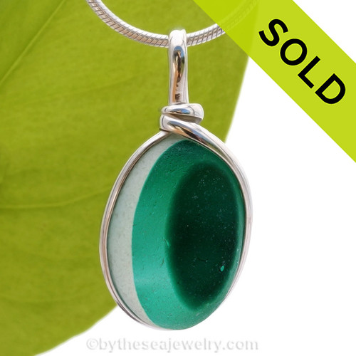 An unusual piece of mixed Teal Green English Multi sea glass set for a necklace in our Original Sea Glass Bezel© in solid sterling silver setting.