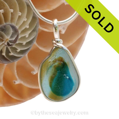 An vivid Electric Aqua and Peridot Green Mixed English Multi Sea Glass Pendant set for a necklace in our Original Bezel© in solid sterling silver setting. This piece does have some flaws but is a fine example of an ultra rare piece with more than 2 colors. SOLS, sorry this Sea Glass Jewelry Item Has Been SOLD!