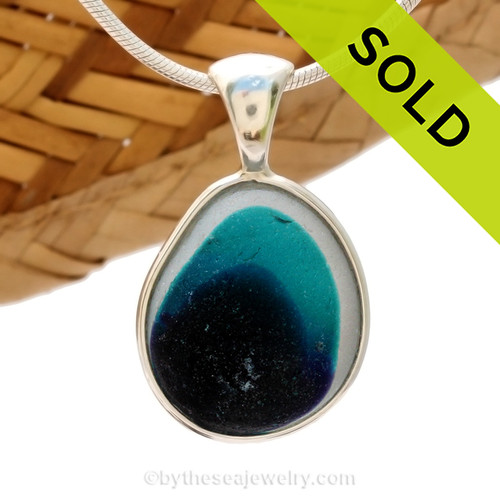 This ultra rare Seaham mixed teal, purple and white sea glass multi color pendant is set in our Deluxe Wire Bezel© pendant setting. An amazing Seaham Multi sea glass piece with a vivid teal mixed in a white base.  Sorry this Sea Glass Jewelry selection is no longer available.
