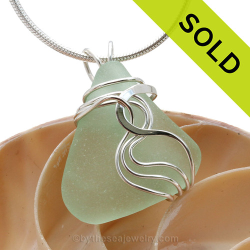 A nice TOP QUALITY piece of Seafoam Green Genuine Sea Glass Pendant set in our Signature Waves© setting in Sterling Silver. Sorry this sea glass jewelry item has been sold!