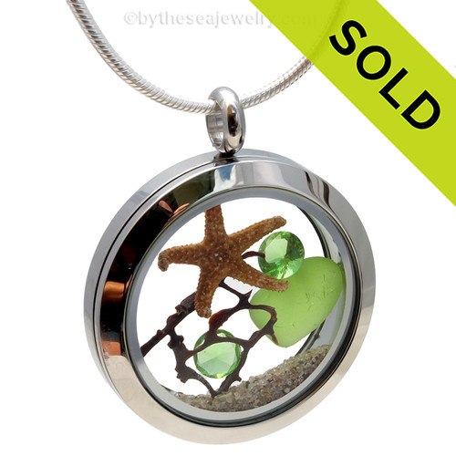 Genuine lime green and cobalt blue sea glass piece combined with a real starfish, a bit of vintage seafan and real beach sand in this stainless steel locket. SOLD - Sorry this Sea Glass Locket is NO LONGER AVAILABLE!