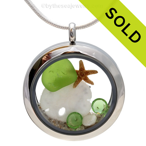 Genuine vivid  lime green sea glass piece combined with a real sandollar,, fresh water pearls and real beach sand in this stainless steel locket. Sorry this sea glass jewelry selection has been sold!