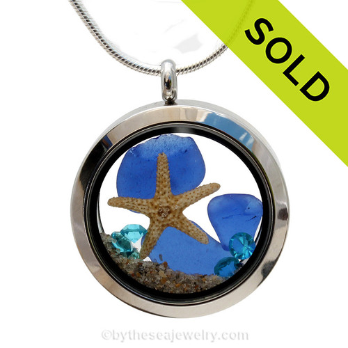 A beautiful pieces of natural blue sea glass combined in a stainless steel locket necklace with a real starfish and beach sand. Vivid Aquamarine crystal gems are added for a bit of beachy bling. Sorry this sea glass jewelry selection has been sold!