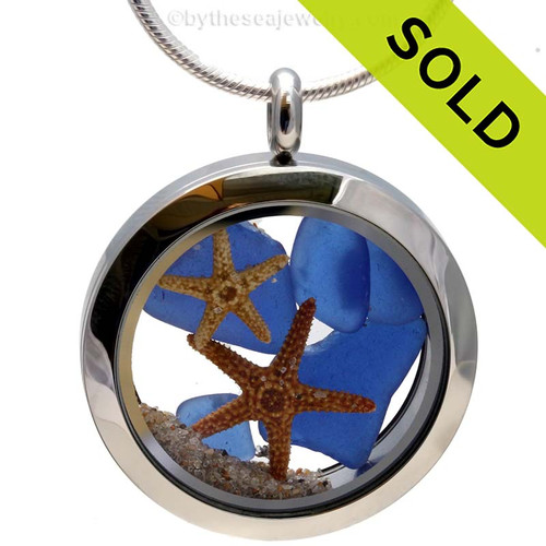 A beautiful pieces of natural blue sea glass combined in a stainless steel locket necklace with two real starfish and beach sand. Sorry this Sea Glass Jewelry selection has been SOLD!
