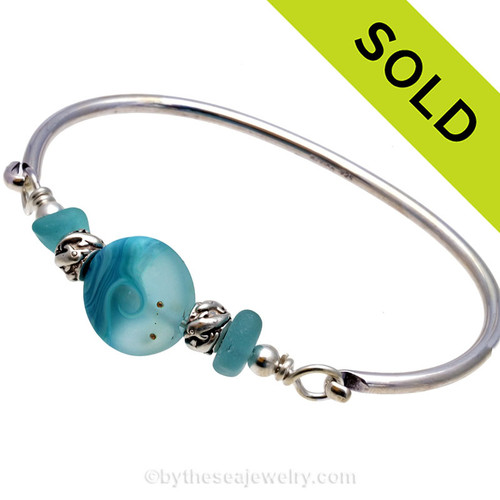 Two larger pieces of beach found sea glass in VIVID tropical aqua on this solid sterling silver half round sea glass bangle bracelet. Sorry this sea glass jewelry selection has been sold!