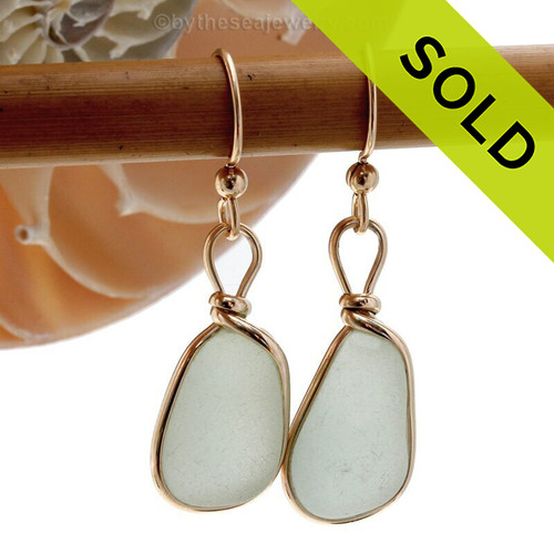 Genuine beach found vivid sea green sea glass earrings in a 14K Rolled Gold Original Wire Bezel setting. Bright green perfectly matched beach found sea glass pieces. REMEMBER- We do no alter or shape our sea glass in any way. This is a perfect sea glass in a natural state, just the way it was found on the beach!