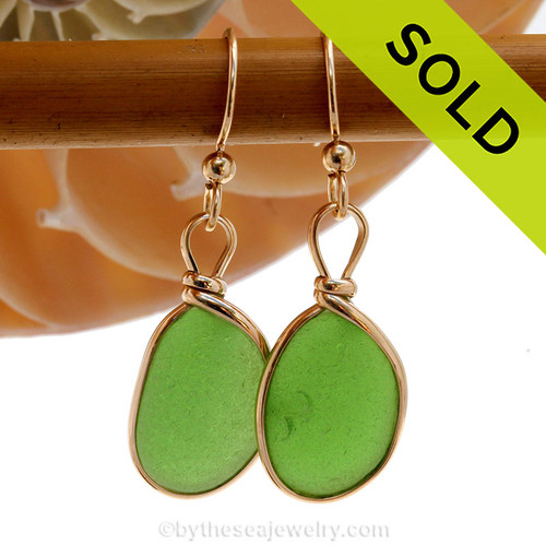 Vivid green sea glass earrings in a 14K Rolled Gold Original Wire Bezel setting. A natural  green perfectly matched sea glass pieces.  Sorry this sea glass jewelry item has been sold!