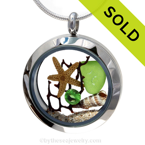 Genuine lime green sea glass piece combined with a real starfish, a small trumpet shell, a bit of vintage seafan and real beach sand in this stainless steel locket. Sorry this Sea Glass Jewelry selection has been SOLD!