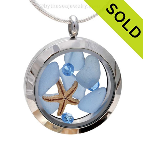 A beautiful pieces of natural Carolina Blue sea glass combined in a stainless steel locket necklace with a real starfish & Zircon Blue crystal Gems. Sorry this One of A Kind Sea Glass Locket has been SOLD!