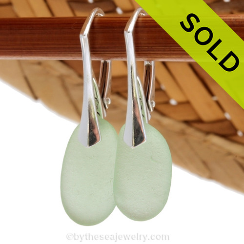 A pair of natural surf tumbled sea glass earrings in a brilliant sea green on solid sterling leverbacks. Simple and elegant with genuine sea glass pieces. Sorry these Sea Glass Earrings are no longer available.