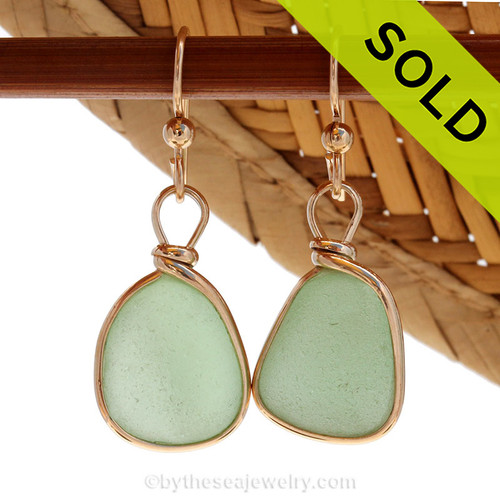 Perfect natural seafoam green sea glass pieces set in our in 14K G/F Original Wire Bezel© earring setting. This setting leaves the glass UNALTERED from the way it was found on the beach.  Sorry these Sea Glass Earrings have been SOLD!