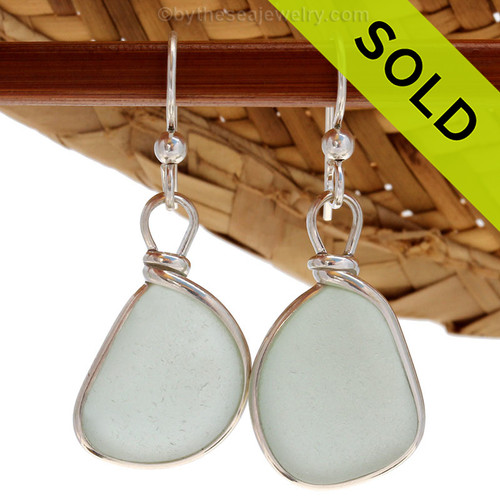 Genuine beach found Pales Aqua Sea Glass Earrings in a Solid Sterling Silver Original Wire Bezel© setting.  Sorry this Sea Glass Jewelry selection is no longer available.