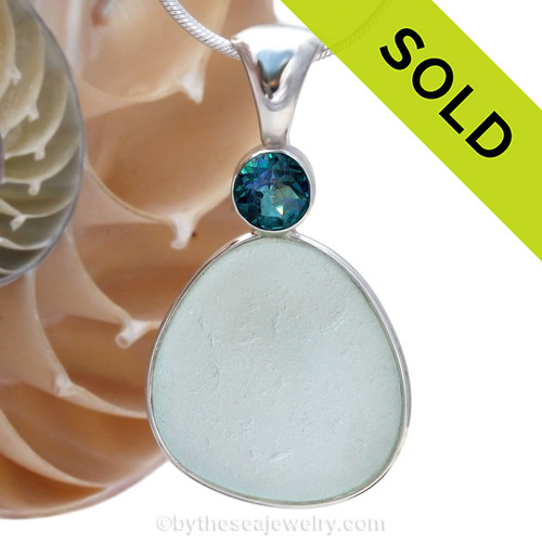 A LARGE PERFECT piece of top quality pale aqua English sea glass pendant set with a large Rainbow Topaz gem in a tube bezel setting. Sorry this one of a kind Sea Glass Jewelry piece has been SOLD!