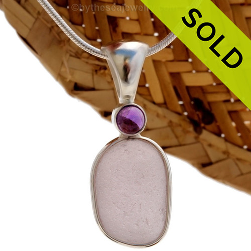 This beautiful Bright Perfect Purple sea glass piece is set in our Deluxe Wire Bezel© pendant setting with a genuine Amethyst Domed gem. Sorry this one of a kind Sea Glass Jewelry Piece has been SOLD!