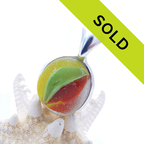 A truly once in a lifetime piece of sea glass. Whether it was a marble or glass art cane used in decorative glass making is unsure, it is however the only piece like it in the world today!