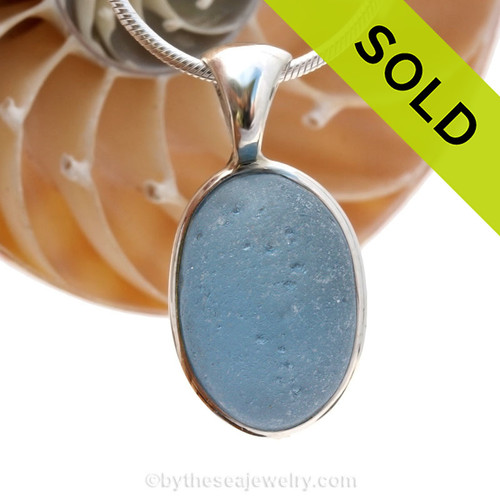 This is a beautiful Carolina Blue Bubbled Sea Glass set in our Deluxe Wire Bezel© pendant setting.  Sorry this sea glass jewelry piece has been sold!