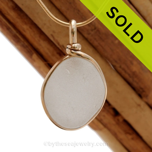 A white natural sea glass piece set in our Original Wire Bezel setting in 14K Rolled Gold setting. Shown here on our 1MM snake chain which is available as an upgrade. SOLD - sorry this Sea Glass Pendant is no longer available.