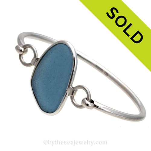 Genuine Gray Blue Sea Glass Bangle Bracelet set in our Deluxe Wire Bezel© sterling silver setting. Sorry this sea glass bracelet has been sold!